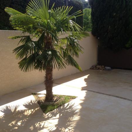Traitement extérieur des enduits rustier de sol façon béton ciré